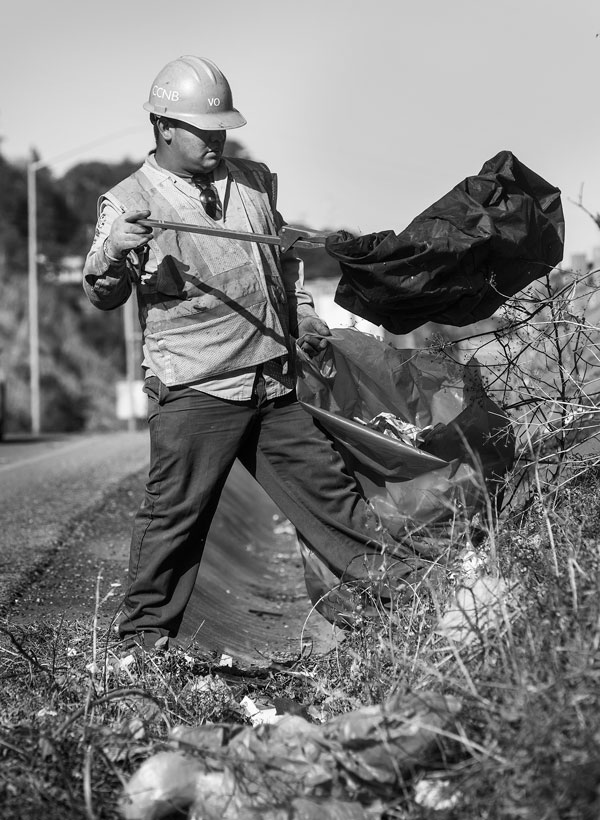 Conservation Corps North Bay, CCNB, picking up litter on U.S. Highway 101