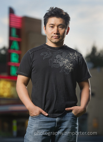 John Truong, photographer, in front of the Lark Theater